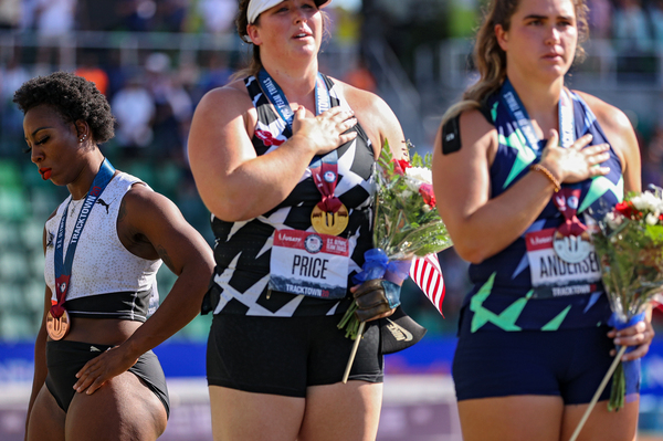 Gwendolyn Berry (left) turned away from the U.S. flag in protest on the podium after the Women's Hammer Throw final of the 2020 U.S. Olympic Track & Field Team Trials last month.