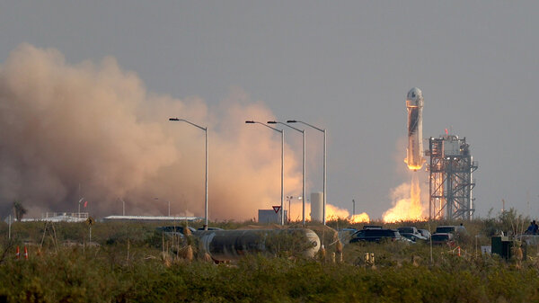 The New Shepard Blue Origin rocket lifts-off from the launch pad carrying Jeff Bezos along with his brother Mark Bezos, 18-year-old Oliver Daemen, and 82-year-old Wally Funk prepare to launch on Tuesday in Van Horn, Texas. The crew are riding in the first human spaceflight for the company.
