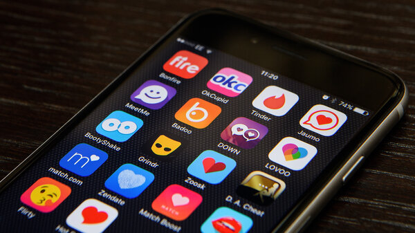 """A selection of online dating app logos are seen on a mobile phone screen. Google searches for """"dating"""" have jumped to a 5-year high."""