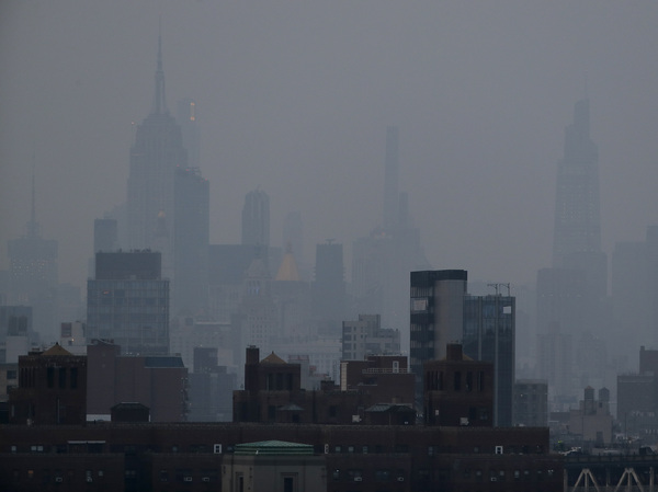 A thick haze hangs over Manhattan on Tuesday. Wildfires in the West, including the Bootleg Fire in Oregon, are creating hazy skies and poor air quality as far away as the East Coast.
