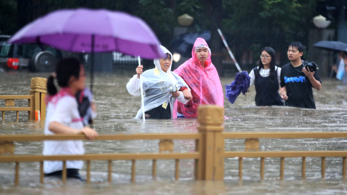 China blows up dam to divert massive flooding in Henan province: NPR