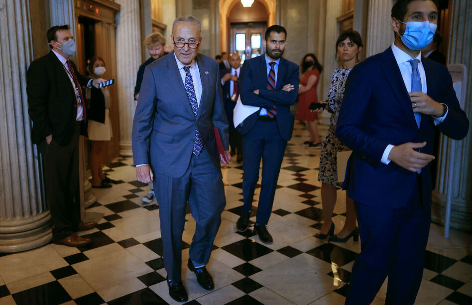 Senate Majority Leader Chuck Schumer, D-N.Y., walks off the Senate floor Wednesday during a procedural vote on the bipartisan infrastructure bill that ultimately failed. (Chip Somodevilla/Getty Images)