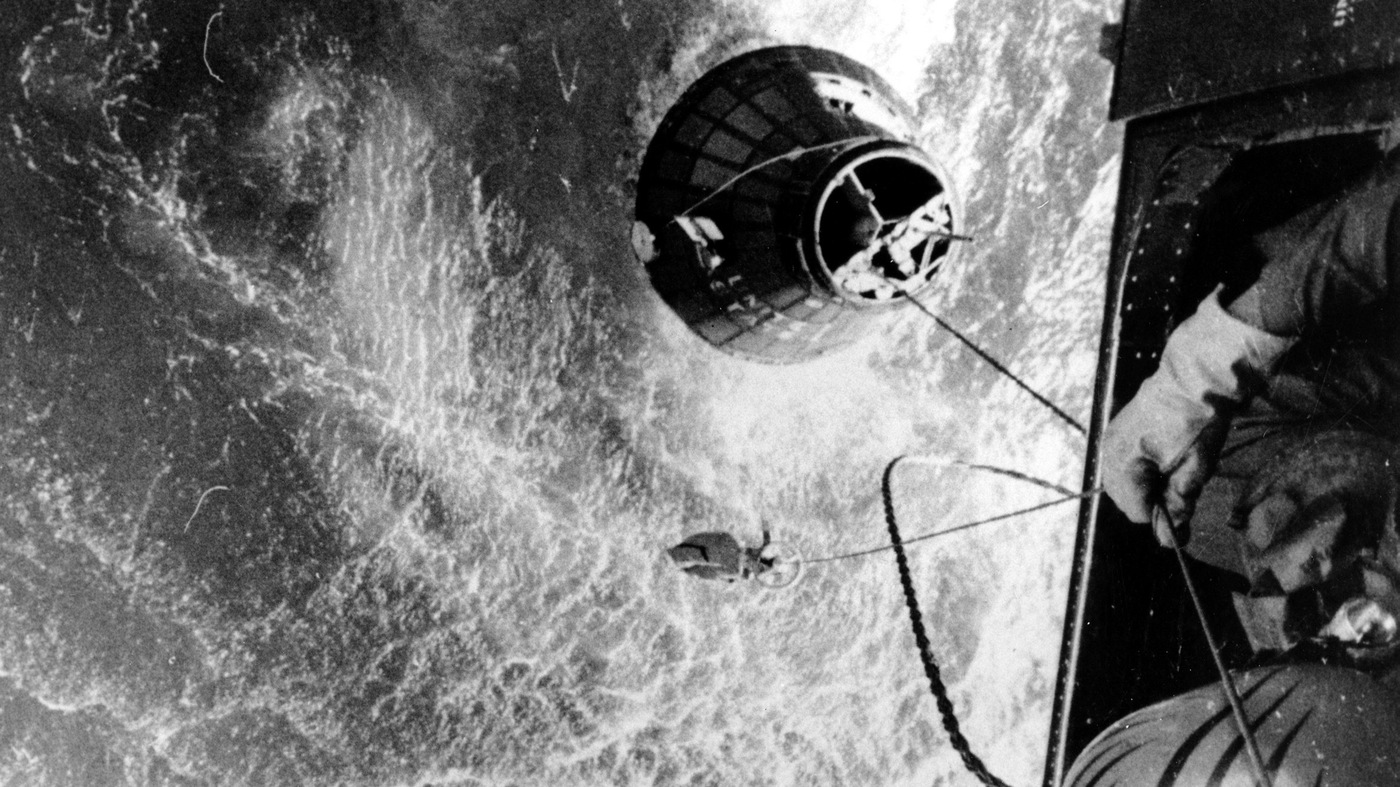 A U.S. Marines helicopter hovers over the Atlantic ocean during an attempt to retrieve astronaut Gus Grissom's Liberty Bell 7, which