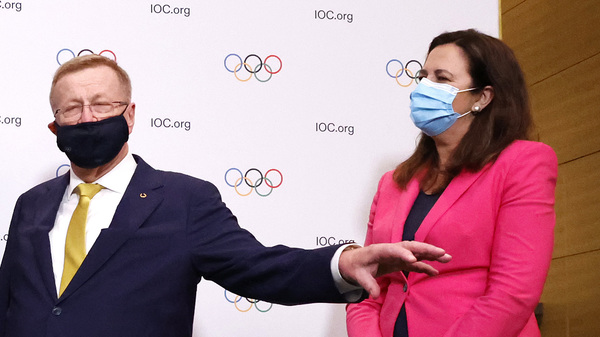 John Coates, president of the Australian Olympic Committee, center, is coming under fire for his remarks to Queensland Premier Annastacia Palaszczuk, right, ordering her to attend the opening ceremony of the Tokyo Olympics.