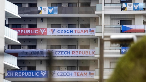 Banners of the Czech Republic (bottom) and the Olympic Refugee teams (top) are seen on a building at the Olympic and Paralympic Village ahead of the 2020 Tokyo Olympics. The Czech team is investigating a cluster of coronavirus cases.