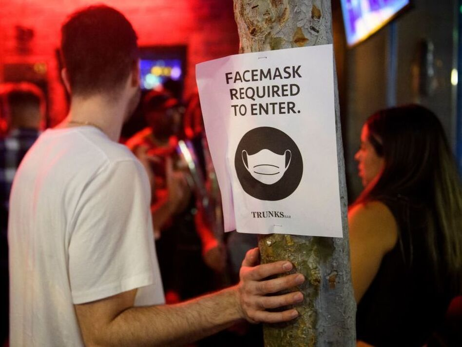 The Centers for Disease Control and Prevention hasn't budged on its guidance that vaccinated people can skip mask-wearing, but some local governments faced with surging cases are going back to mandates, such as Los Angeles County, which recently mandated indoor mask use, including at places like bars and restaurants. (Patrick T. Fallon/AFP via Getty Images)