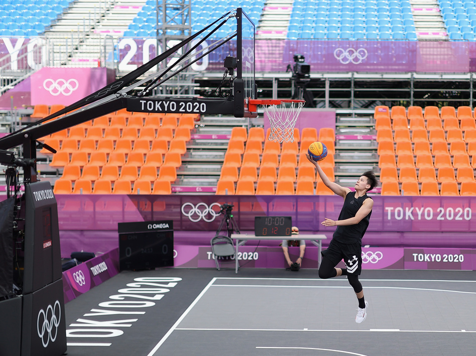 Many Olympic athletes at the Tokyo Summer Games are having to get used to empty stands, the occasional coronavirus quarantine and loneliness. Zhiting Zhang of Team China practices in 3x3 basketball at deserted Aomi Urban Sports Park. (Christian Petersen/Getty Images)