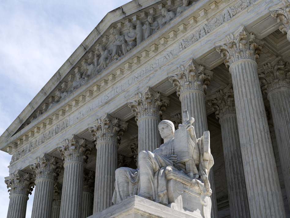 The U.S. Supreme Court will review next term whether all state laws that ban abortions before fetal viability are unconstitutional. (Jose Luis Magana/AP)