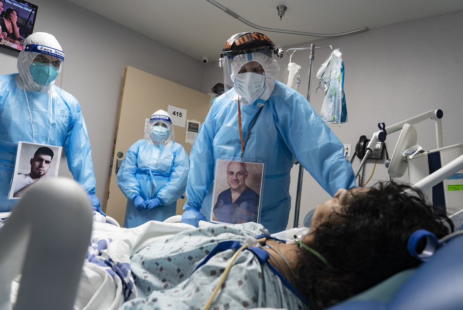 Medical staff members check on a patient in the COVID-19 Intensive Care Unit at United Memorial Medical Center in Houston last November. Doctors are now investigating whether people with lingering cognitive symptoms may be at risk for dementia. (Go Nakamura/Bloomberg via Getty Images)