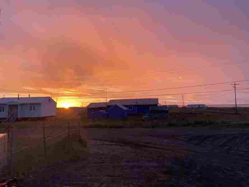 The sun rises over Mekoryuk, Alaska.