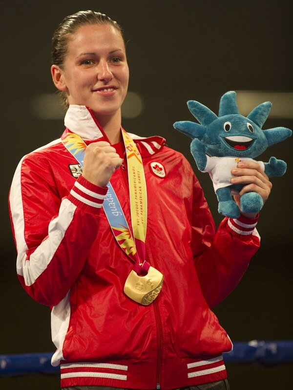Canadian Mandy Bujold celebrates with her Gold medal after finish in the women's 51Kg weight final encounter during the 2011 Pan-American Games in Mexico.
