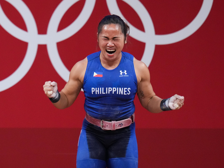Hidilyn Diaz of the Philippines celebrates winning the women's 55-kilogram weightlifting match at the Tokyo 2020 Games — her country's first Olympic gold medal. (An Lingjun/CHINASPORTS/VCG via Getty Images)