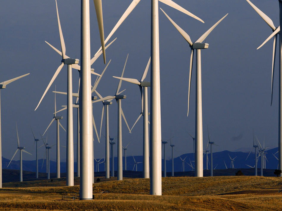 A wind farm in Wyoming generates electricity for a region that used to be more dependent on coal-fired power plants. A new study finds that millions of lives could be saved this century by rapidly reducing greenhouse gas emissions. (Matt Young/AP)