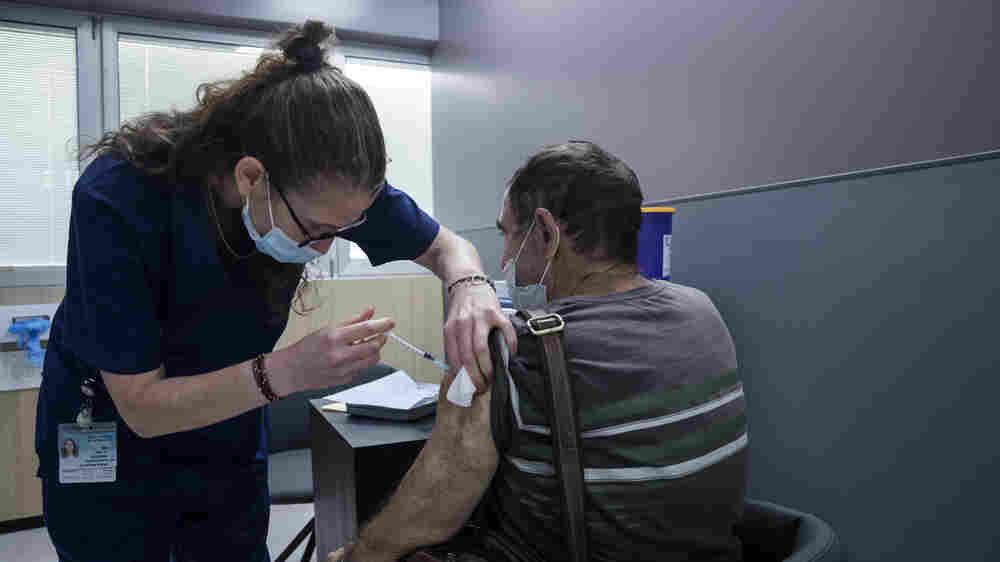 COVID Symptoms May Linger In Some Vaccinated People Who Get Infected, Study Finds