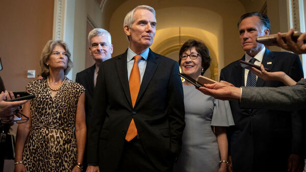 The lead GOP negotiators on the bipartisan infrastructure legislation — Sens. Lisa Murkowski (from left), Bill Cassidy, Rob Portman, Susan Collins and Mitt Romney — speak to reporters Wednesday at the U.S. Capitol.