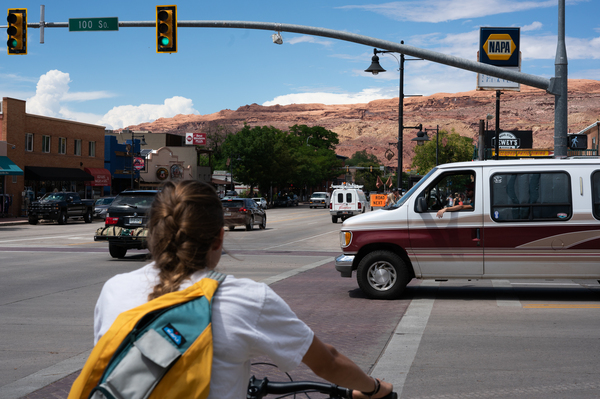 Traffic in downtown Moab. In the 1950s, it was a sleepy uranium mining town.
