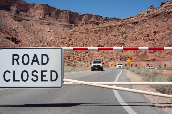 The gate to Arches National Park is closed on a weekday morning last month.
