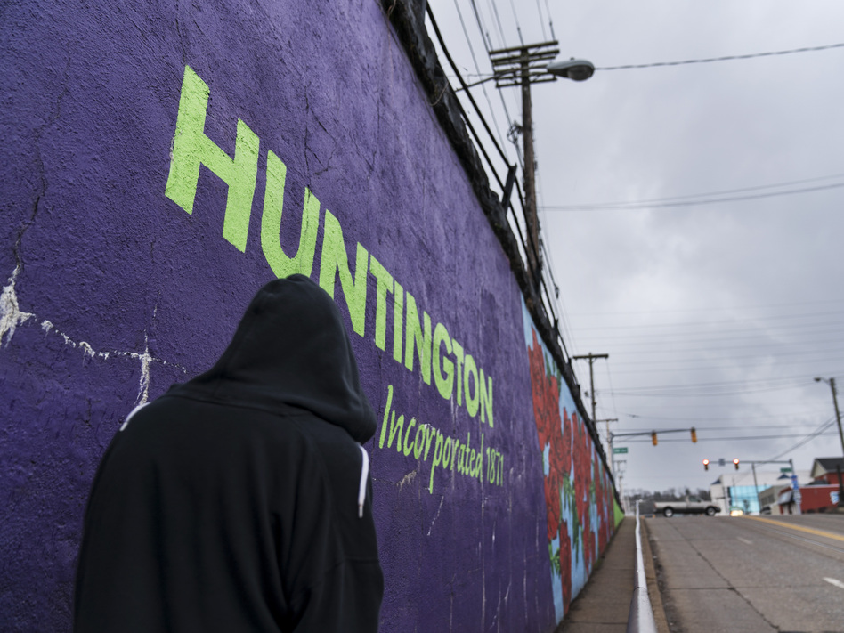 A pedestrian walks past a mural in Huntington, W.Va., on March 18. Huntington was once ground zero for the U.S. opioid epidemic. (David Goldman/AP)