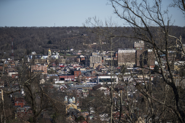 Downtown Huntington, W.Va., is seen through the trees on March 19. Other communities are watching the trial in West Virginia as they build their own legal cases against drug companies.