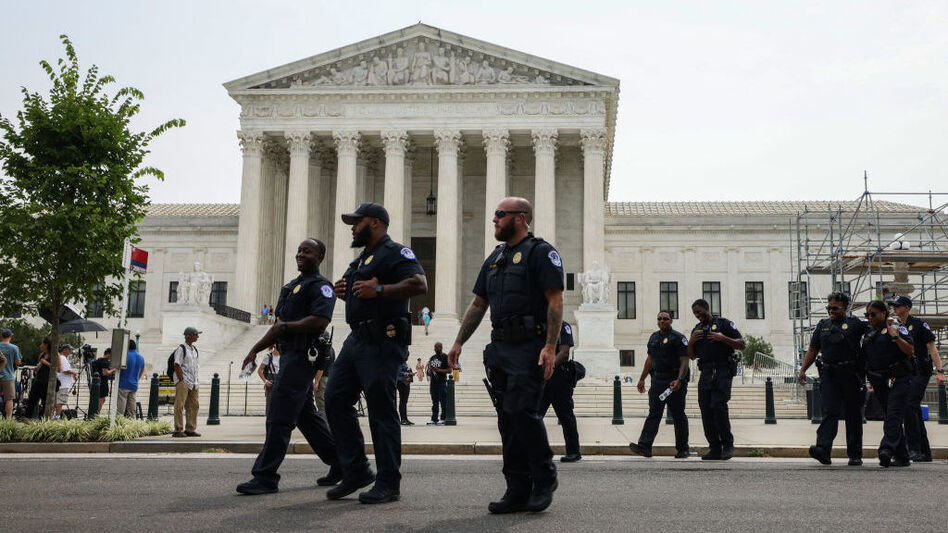 U.S. Capitol police officers walk near the Capitol complex on July 19. Congress voted to extend funding for the force. (Anna Moneymaker/Getty Images)