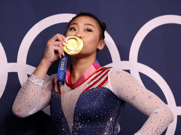 Sunisa Lee of the U.S. poses with her gold medal after winning the women's all-around final at the Tokyo Olympics on Thursday.
