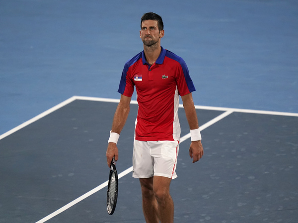 Serbia's Novak Djokovic  looks upset after he was defeated by Germany's Alexander Zverev during a semifinal match of the tennis competition on Friday at the Summer Olympics.