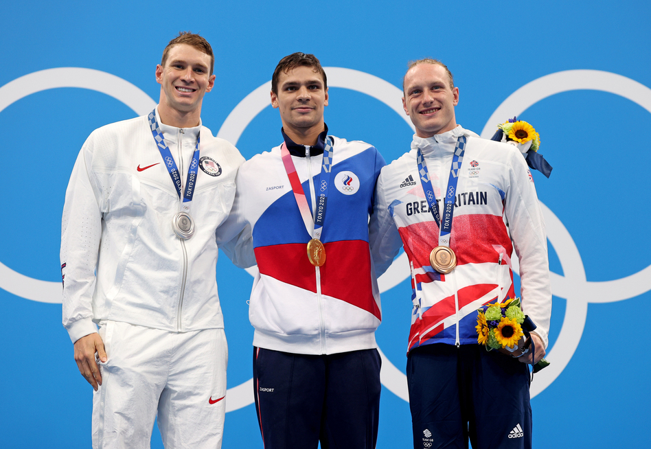 Silver medalist Ryan Murphy of Team USA (from left), gold medalist Evgeny Rylov of the Russian Olympic Committee and bronze medalist Luke Greenbank of Great Britain during Friday's medal ceremony for the men's 200-meter backstroke final at the Tokyo Games. (Maddie Meyer/Getty Images)