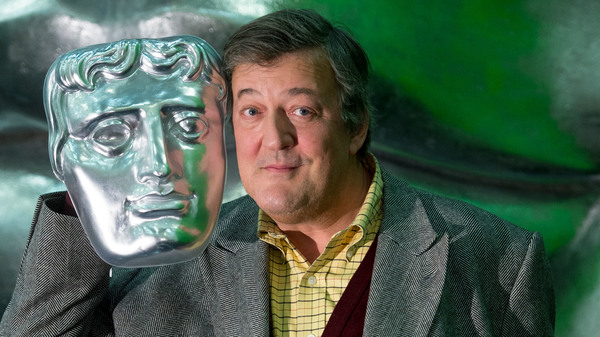 Stephen Fry poses on stage with a BAFTA mask ahead of the British Academy Film Awards at the Royal Opera House on Feb. 5, 2015, in London.