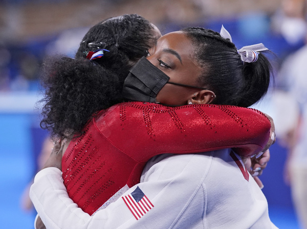 Simone Biles embraces teammate Jordan Chiles after she exited the team final at the Summer Olympics in Tokyo.