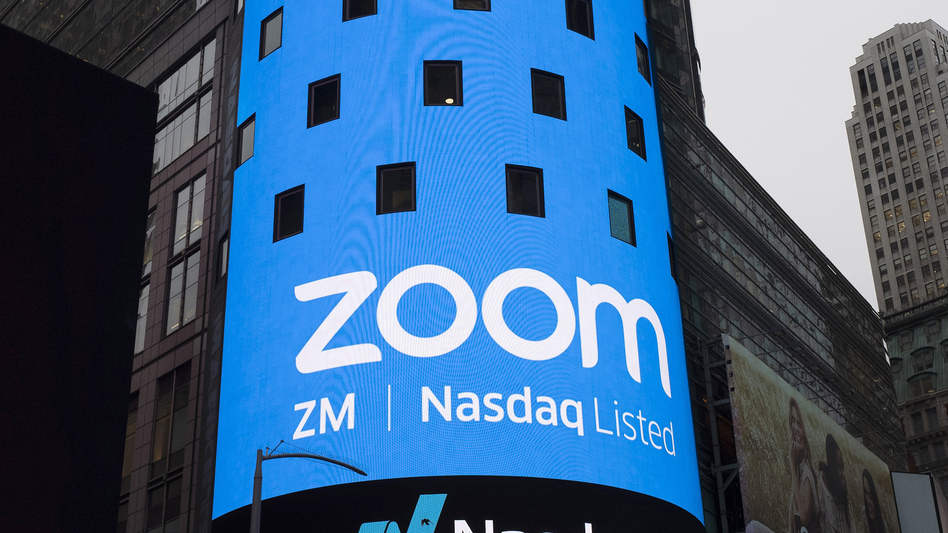 A sign for Zoom Video Communications is pictured ahead of the company's Nasdaq IPO in New York in 2019. The company has agreed to a preliminary settlement in a privacy lawsuit. (Mark Lennihan/AP)