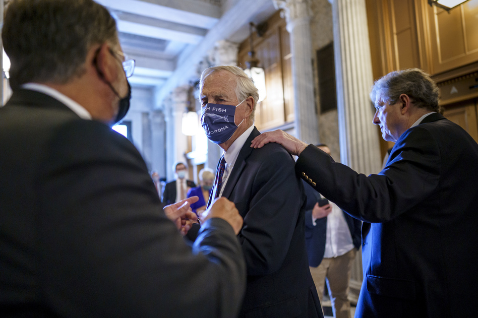 Sen. Angus King, I-Maine, center, speaks with Sen. Gary Peters, D-Mich., left, while Sen. John Kennedy, R-La., walks by at right, as the Senate voted to formally begin debate on a roughly $1 trillion infrastructure plan on Friday. (J. Scott Applewhite/AP)