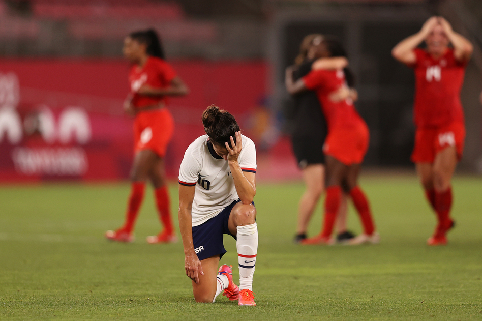 Carli Lloyd of the U.S. women's soccer team looks dejected after Monday's defeat in the semifinal match against Canada at the Tokyo Olympics. (Francois Nel/Getty Images)
