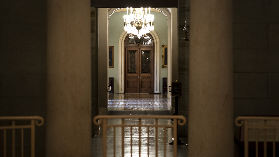 Empty hallways outside the U.S. Senate chamber, where the body will consider major pieces of legislation that could allocate trillions of dollars for infrastructure and other priorities. (Drew Angerer/Getty Images)