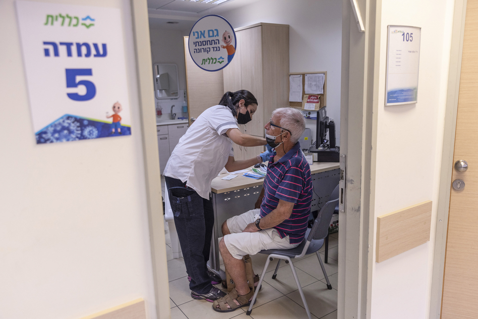 The director of WHO now says that a booster moratorium should be in force until 10% of the population in all countries is vaccinated. Israel had previously announced plans to give a third Pfizer dose to residents age 60 and up after an uptick in COVID cases. Above: Administering a booster on August 2 in Tel Aviv. (Kobi Wolf/Bloomberg via Getty Images)