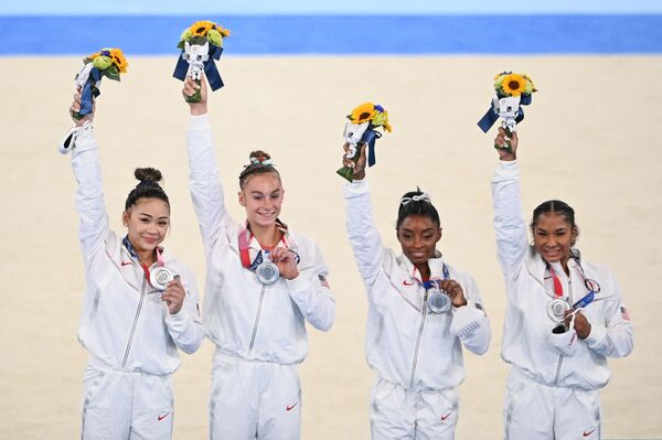 U.S. gymnasts Sunisa Lee, Grace McCallum, Simone Biles and Jordan Chiles celebrate winning the silver medal during the podium ceremony of the artistic gymnastics women's team final at the Tokyo Olympic Games.