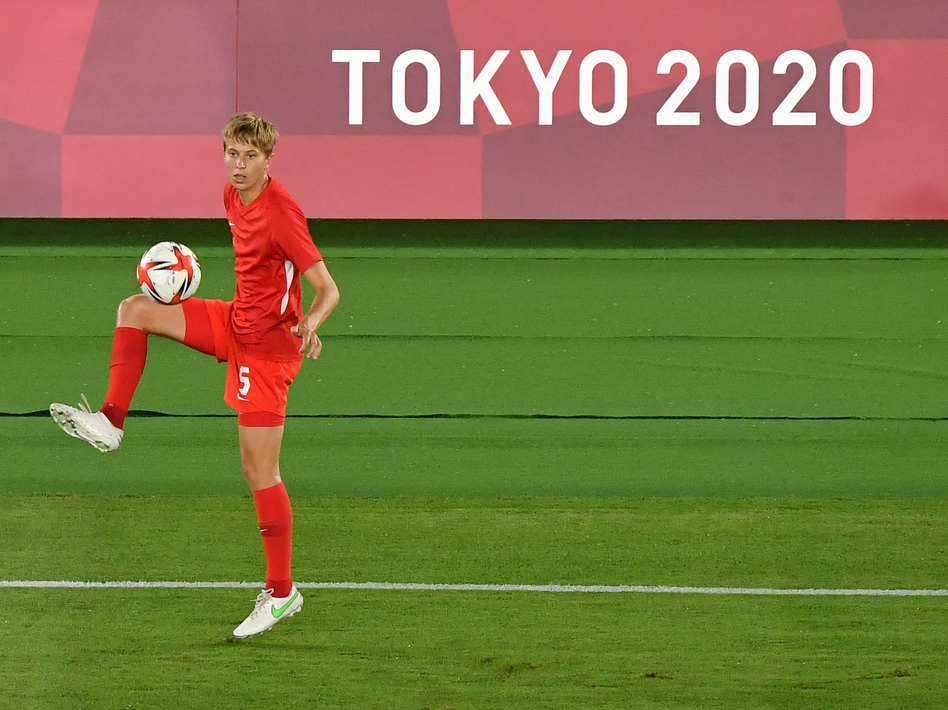 Canada's midfielder Quinn warms up prior to the Tokyo Olympics women's final soccer match between Sweden and Canada on Aug. 6.