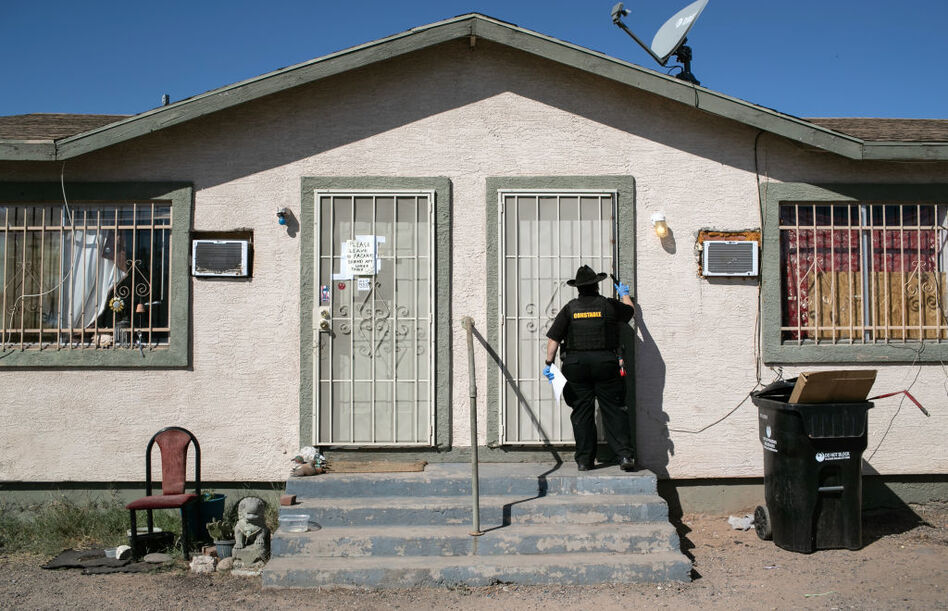 Maricopa County constable Darlene Martinez knocks on a door before posting an eviction order on Oct. 1, 2020, in Phoenix. An extended eviction moratorium ordered by the Centers for Disease Control and Prevention has been struck down. (John Moore/Getty Images)