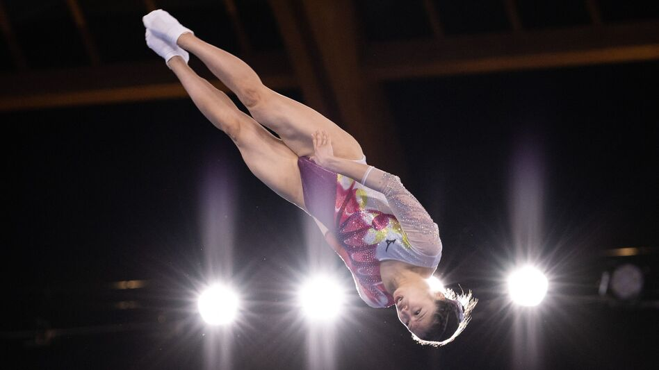 Japan's Megu Uyama competes in the women's final of the Trampoline Gymnastics event. It would take a very tall photo to show you where the trampoline is.