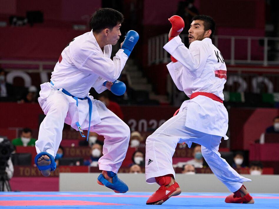 Japan's Ryutaro Araga (L) competes against Kazakhstan's Daniyar Yuldashev in the men's kumite at the Tokyo 2021 Olympic Games. Bloop-bloop feet!