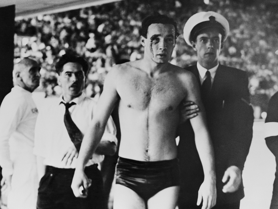 Hungary's Ervin Zador is led from the pool with blood pouring from a cut eye after a water polo match with the Soviet Union descended into chaos at the 1956 Melbourne Olympics. The Games played out in a volatile time — and thanks to a 17-year-old's letter, they ended on a note of unity.
