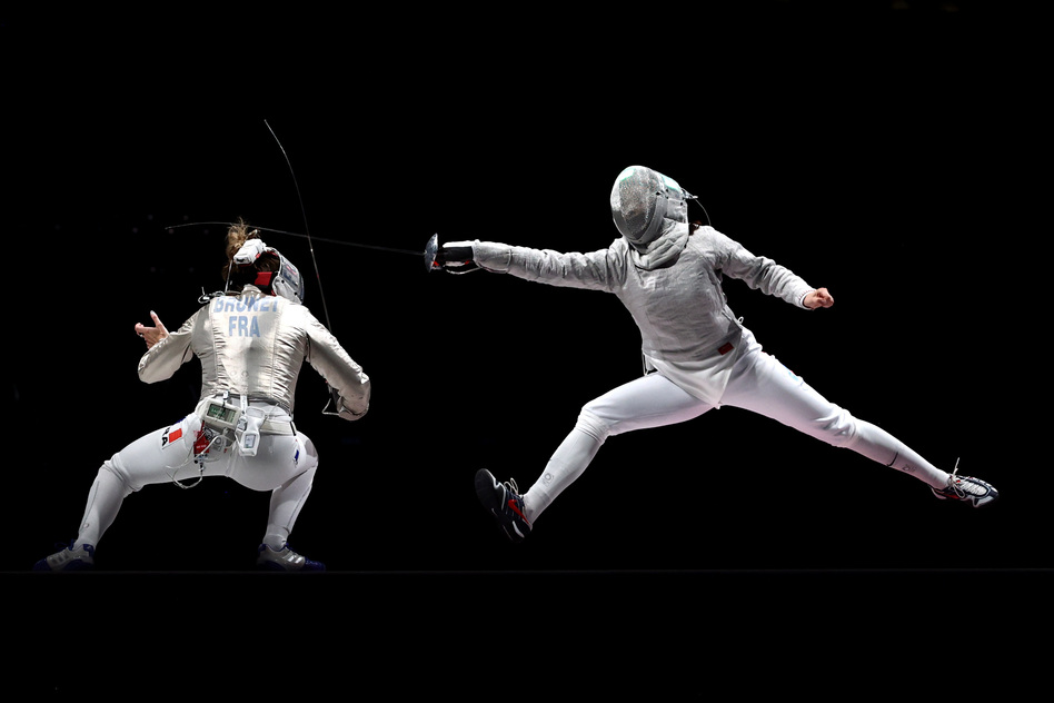 Over two weeks, critic Linda Holmes watched every Olympic discipline, from archery to wrestling. Above, Manon Brunet of Team France, left, competes against Olga Nikitina of Team ROC during the Women's Sabre Team Fencing Gold Medal Match on day eight of the Tokyo 2020 Olympic Games.