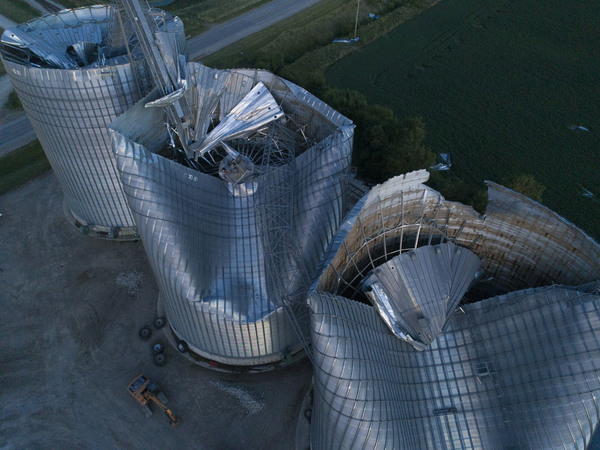 Damaged grain bins are shown at the Heartland Co-Op grain elevator on Aug. 11, 2020, in Malcom, Iowa. Some people are still recovering a year after the 2020 derecho caused $11 billion in damage across the Midwest.