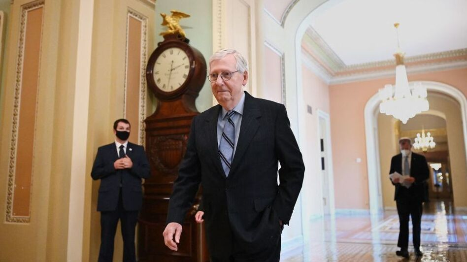 Senate Minority Leader Mitch McConnell of Kentucky is among the 19 Republicans who voted for the $1 trillion infrastructure bill on Tuesday. (Mandel Ngan/AFP via Getty Images)
