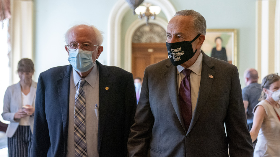 Senate Budget Committee Chair Bernie Sanders, I-Vt., and Senate Majority Leader Chuck Schumer of New York walk out of a budget resolution meeting at the Capitol on Monday. (Andrew Harnik/AP)