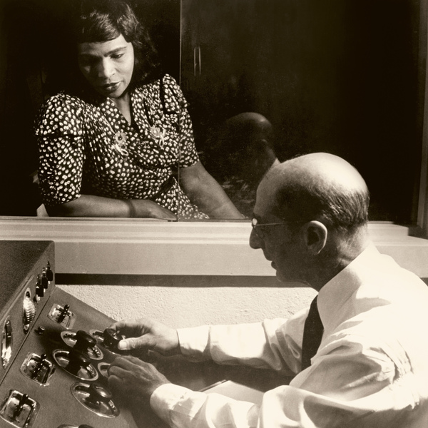 """Anderson at RCA Victor Studio in New York City in 1945. With the Victor Talking Machine Co. (later RCA Victor), Marian Anderson recorded Deep River, then known as the """"Negro spiritual."""" She was afraid this performance in a studio was as much racial tolerance she would receive from white Americans. She made her last recording with RCA in 1966."""