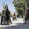 Taliban Sweep Across Afghanistan's South, Taking At Least Three More Cities