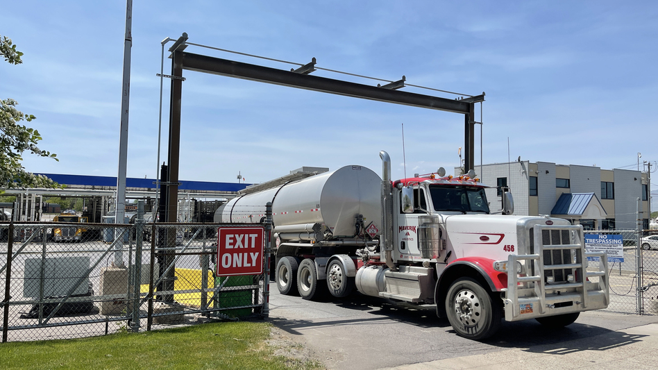 A driver exits the yard after filling up his gas tanker truck at Marathon Oil on May 20 in Salt Lake City. (George Frey/Getty Images)