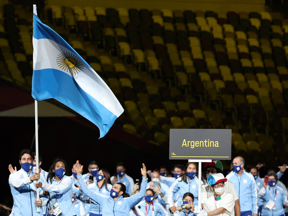 Flag bearers Yanina Andrea Martinez and Rodolfo Ramirez of Team Argentina lead their delegation in the parade of athletes.