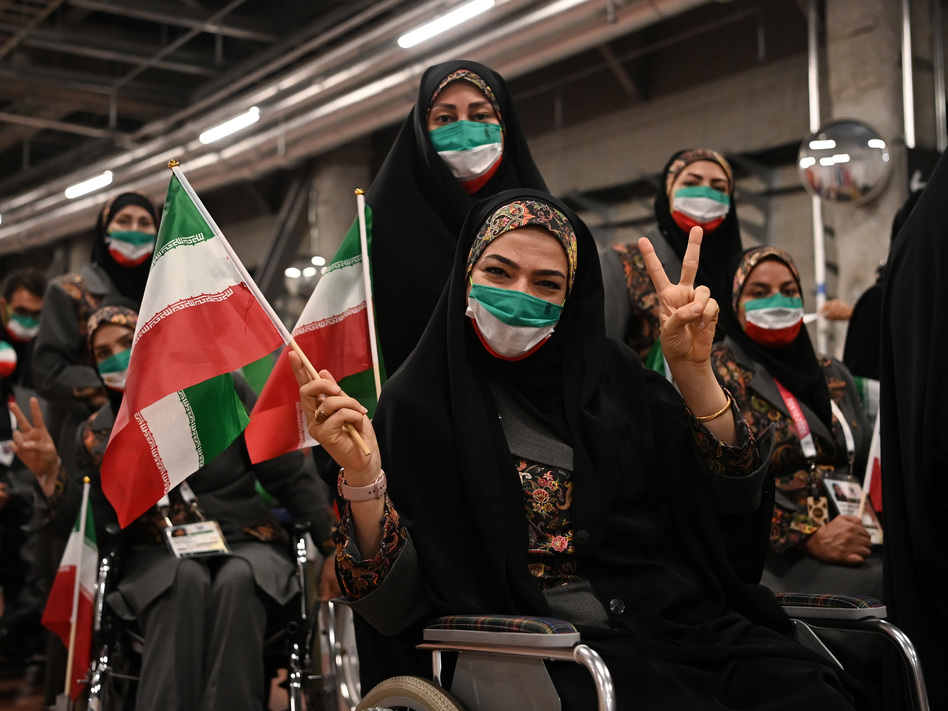 Members of Team Iran pose during the opening ceremony of the Tokyo 2020 Paralympic Games.