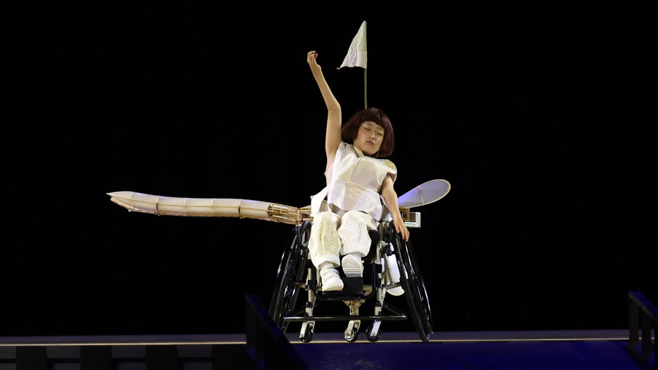 Wago Yui performs the role of a one-winged airplane that learns to symbolically fly during the opening ceremony of the Tokyo 2020 Paralympic Games.